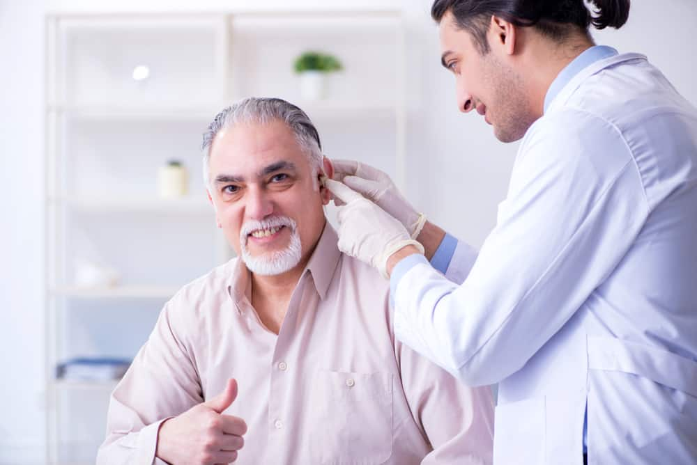 Male patient with hearing problem visiting doctor